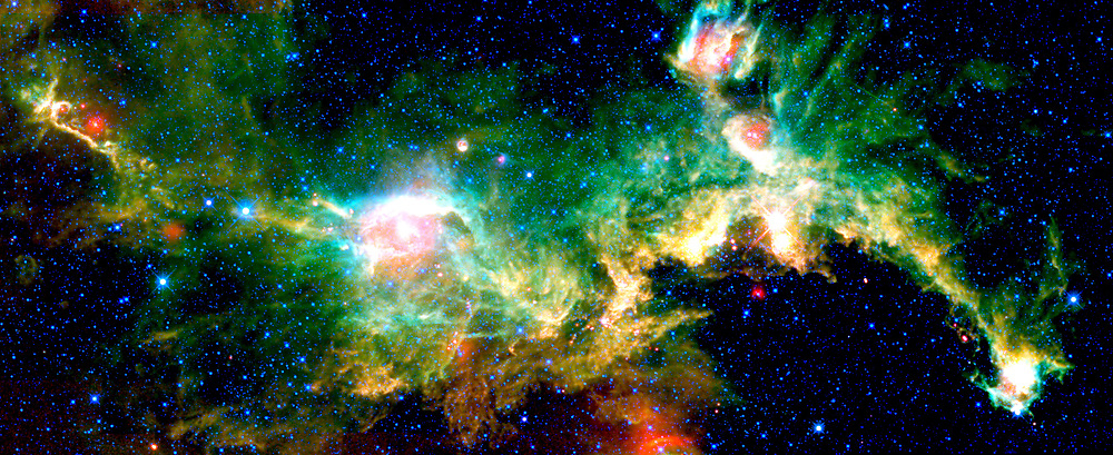 The Seagull nebula, seen in this infrared mosaic from NASA's Wide-field Infrared Survey Explorer, or WISE, draws its common name from it resemblance to a gull in flight. But it depends on your point of view. When the image is rotated 180 degrees it bears a passing resemblance to a galloping lizard -- or perhaps a dragon or a dinosaur. The image spans an area about seven times as wide as the full moon, and three times as high (3.55 by 1.37 degrees), straddling the border between the constellations Monoceros and Canis Major (the Big Dog). So you might say this lizard is running with the Big Dog, while the gull is flying from it. Astronomers catalogue the nebula as IC 2177. This cosmic cloud is one of many sites of star formation within the Milky Way galaxy. It is located 3,800 light-years away from Earth, inside the Orion spur, the same partial spiral arm of the Milky Way where our solar system is located. The nebula is nearly 240 light-years across.