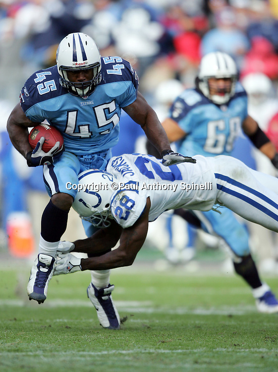 NASHVILLE, TN - DECEMBER 3:  Fullback Ahmard Hall #45 of the Tennessee Titans gets tackled during a running play by defensive back Marlin Jackson #28 of the Indianapolis Colts at LP Field on December 3, 2006 in Nashville, Tennessee. The Titans defeated the Colts 20-17. ©Paul Anthony Spinelli *** Local Caption *** Ahmard Hall;Marlin Jackson