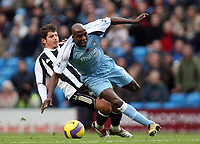 Photo: Paul Thomas.<br /> Manchester City v Newcastle United. The Barclays Premiership. 11/11/2006.<br /> <br /> Hatem Trabelsi (Blue) of Man City gets fouled from behind by Emre.