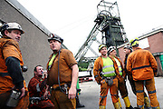 Miners in front of the entrance to the last deep mine in Wales, Tower Colliery are about to start the early morning shift underground on Tuesday, June 19, 2007, in Hirwaun, Vale of Neath, South Wales. The time is ripe again for an unexpected revival of the coal industry in the Vale of Neath due to the increasing prize and diminishing reserves of oil and gas, the uncertainties of renewable energy sources, and the technological advancement in producing energy from coal while limiting emissions of pollutants, has created the basis for valuable investment opportunities and a possible alternative to the latest energy crisis. Unity Mine, in particular, has started a pioneering effort to revive the coal industry in the area, reopening after more than 8 years with the intent of exploiting the large resources still buried underground. Coal could be then answer to both, access to cheaper and paradoxically greener energy and a better and safer choice than nuclear energy as a major supply for the decades to come. It is estimated that coal reserves in Wales amount to over 250 million tonnes, or the equivalent of at least 50 years of energy supply, while the worldwide total coal could last for over 200 years as a viable resource compared to only a few decades of oil and natural gas.