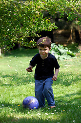 BRUSSELS, BELGIUM - APRIL-25-2007 - A child plays with a football (soccer ball). (PHOTO © JOCK FISTICK)
