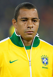 Gilberto Silva of Brazil listening to the national anthem during the 2010 FIFA World Cup South Africa Group G Second Round match between Brazil and République de Côte d'Ivoire on June 20, 2010 at Soccer City Stadium in Soweto, suburban Johannesburg, South Africa.  Brazil defeated Ivory Coast 3-1. (Photo by Vid Ponikvar / Sportida)