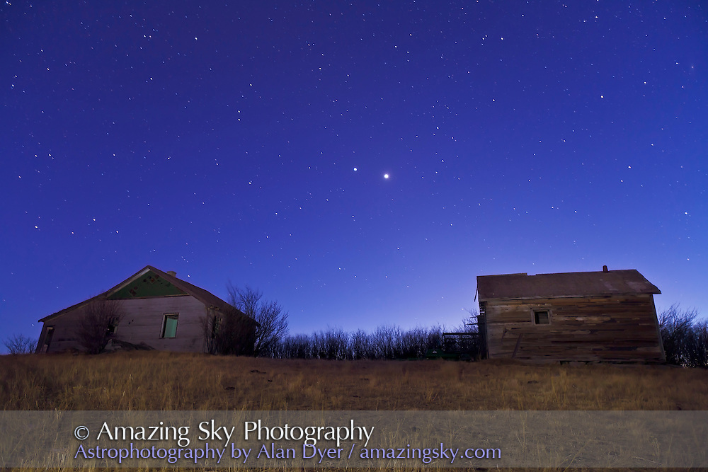 Venus and Jupiter in deep twilight (no moonlight) over old farmstead buildings near home, March 10, 2012. Taken with Canon 5D MkII and 16-35mm lens 24mm and at f/2.8 for 30 seconds at ISO 640. Used an LED flashlight to illuminate the buildings and foreground.