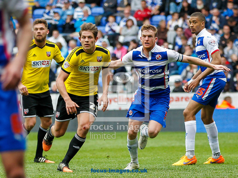 James Tarkowski of Brentford &amp; Alex Pearce of Reading during the Sky Bet Championship match between Reading and y of Brentford at the Madejski Stadium, Reading<br /> Picture by Mark D Fuller/Focus Images Ltd +44 7774 216216<br /> 25/04/2015