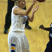 11/11/11 Newark DE: Junior Guard #10 Kayla Miller passes the ball during a week one NCAA Women's College basketball game, Friday, Nov. 11, 2011 at the Bob carpenter center in Newark Delaware...Elena Delle Donne drops a game high 33 points as Delaware defeats the Rhode Island rams 89-53...Special to The News Journal/SAQUAN STIMPSON