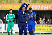 AFC Wimbledon goalkeeping coach Ashley Bayes celebrates wth goalscorer AFC Wimbledon defender Terell Thomas (6) during the EFL Sky Bet League 1 match between AFC Wimbledon and Portsmouth at the Cherry Red Records Stadium, Kingston, England on 19 October 2019.