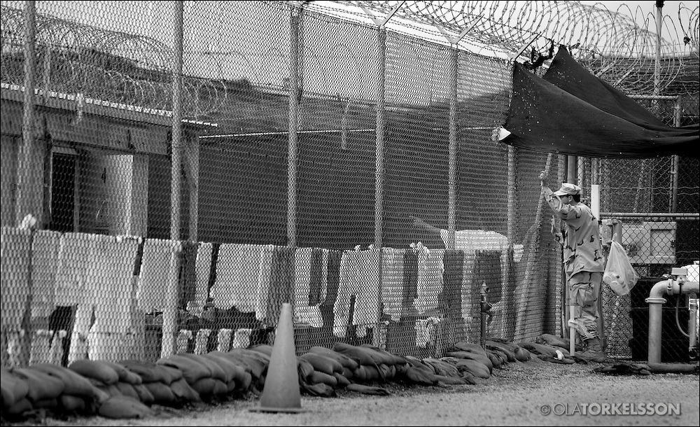 "In the aftermath of the Sept. 11, 2001, attacks on the United States, and after the American invasion of Afghanistan, prisoners suspected of being al Qaeda members or supporters were transported to the Guantánamo military prison. In 2002, President George W. Bush made it the central prison for suspects considered unlawful enemy combatants in the newly christened ""war on terror."""