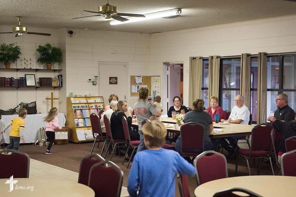 The Rev. Edward DeWitt leads a devotion following a fellowship meal at Lutheran Church of the Redeemer on Thursday, Feb. 12, 2015, in Sanford, Fla. LCMS Communications/Erik M. Lunsford