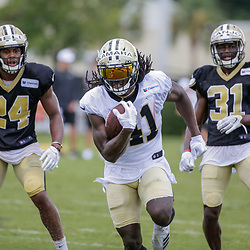 Jul 28, 2019; Metairie, LA, USA; New Orleans Saints running back Alvin Kamara (41) runs past strong safety Vonn Bell (24) and defensive back Chris Banjo (31) during training camp at the Ochsner Sports Performance Center. Mandatory Credit: Derick E. Hingle-USA TODAY Sports