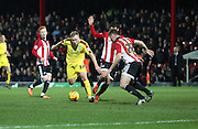 Burnley midfielder Scott Arfield attacking during the Sky Bet Championship match between Brentford and Burnley at Griffin Park, London, England on 15 January 2016. Photo by Matthew Redman.