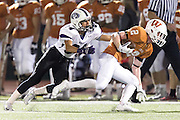 Westwood's Travis Wilde gets stopped by Cedar Ridge's Julian Jimenez Friday at Dragon Stadium.