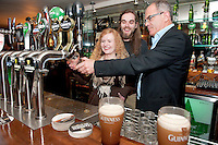 Guinness Master Brewer Fergal Murray shows Willie Keneally Nenagh and  Jenny Comerford Tara Grove how to pour a pint at the GUINNESS Mid-Strength Taste Test Tour. Guinness Master Brewer Fergal Murray and former Irish Rugby International Mick Galwey hosted the event, which featured a special Q&A on rugby and a Pour Your Pint Competition. .Full details are available on www.Facebook.com/Guinnessireland GUINNESS Mid-Strength has the unmistakable distinctive taste and is brewed in exactly the same way as GUINNESS, just with less alcohol at 2.8%...The GUINNESS word and associated logos are trademarks...Enjoy Guinness Sensibly...Visit www.drinkaware.ie..
