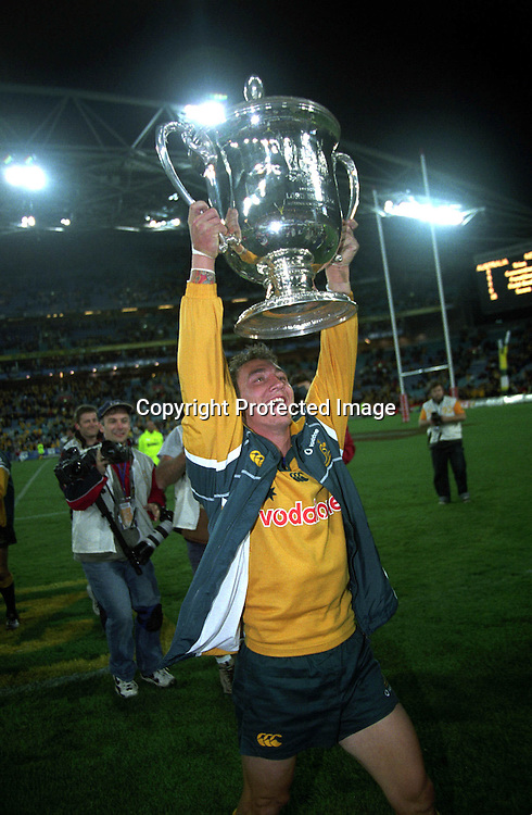 Mat Rogers celebrates after the rugby union Bledisloe Cup match between the All Blacks and Australia, Syndey, 3 August 2002. Photo: PHOTOSPORT