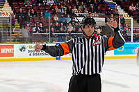 KELOWNA, BC - OCTOBER 12: Referee Tyler Adair signals the bench of the Kelowna Rockets against the Kamloops Blazers at Prospera Place on October 12, 2019 in Kelowna, Canada. (Photo by Marissa Baecker/Shoot the Breeze)