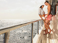 Young couple flirting on yacht side view