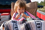"09 SEPTEMBER 2007 -- ST. MICHAELS, AZ: NIZHONI DAVIS, 2, from Ft. Defiance, AZ, watches the action at a traditional Navajo Horse Race in the summit area of the Navajo Indian reservation about 10 miles west of St. Michaels, AZ. Traditional horse racing is making a comeback on the Navajo reservation. The races are run on improvised courses that vary depending on the local terrain. Use of saddles is optional (except in the ""Cowhand Race"" which requires a western style saddle) and many jockeys ride bareback. The distances vary from one mile to as long as thirty miles. Traditional horse races were common until the 1950's when they fell out of favor, but there has been a resurgence in traditional racing since the late 1990's and now there is a traditional horse racing circuit on the reservation. The race was organized by the Begay family of Steamboat, AZ and run on private land about three miles from a paved road.  Photo by Jack Kurtz"