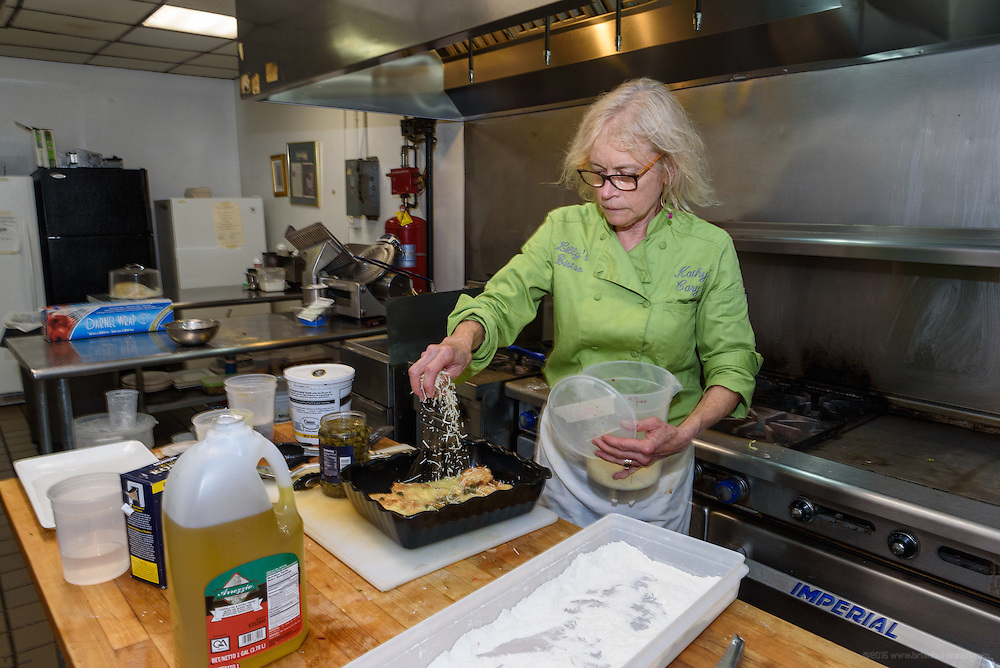 Chef Cary prepares a dish for La Peche. Lunchtime in the kitchen at Lilly's Monday, Aug. 15, 2016 with Chef/Owner Kathy Cary and staff. (Photo by Brian Bohannon)