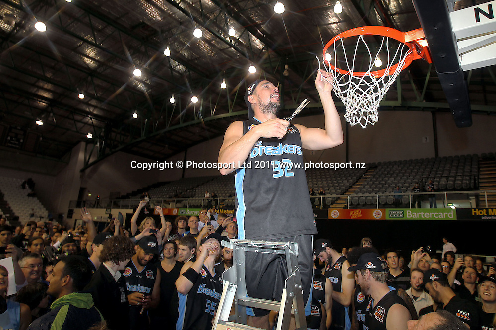Breakers' Paul Henare cuts the net. iinet ANBL, Grand Final Game 3, New Zealand Breakers vs Cairns Taipans, North Shore Events Centre, Auckland, New Zealand. Friday 29th April 2011. Photo: Anthony Au-Yeung / photosport.co.nz