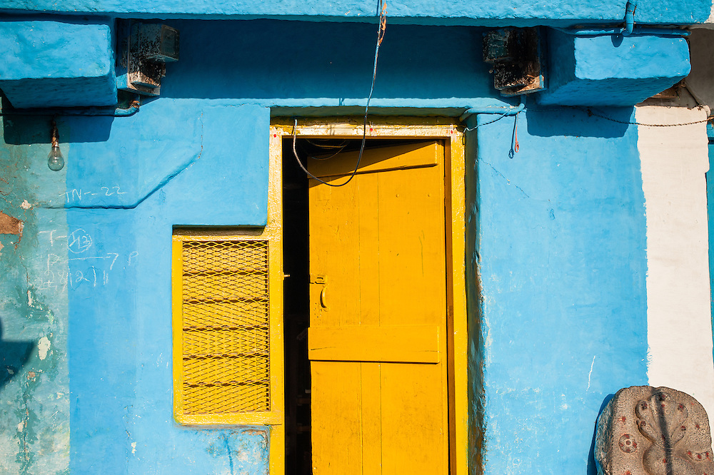 Yellow door in blue house (India)