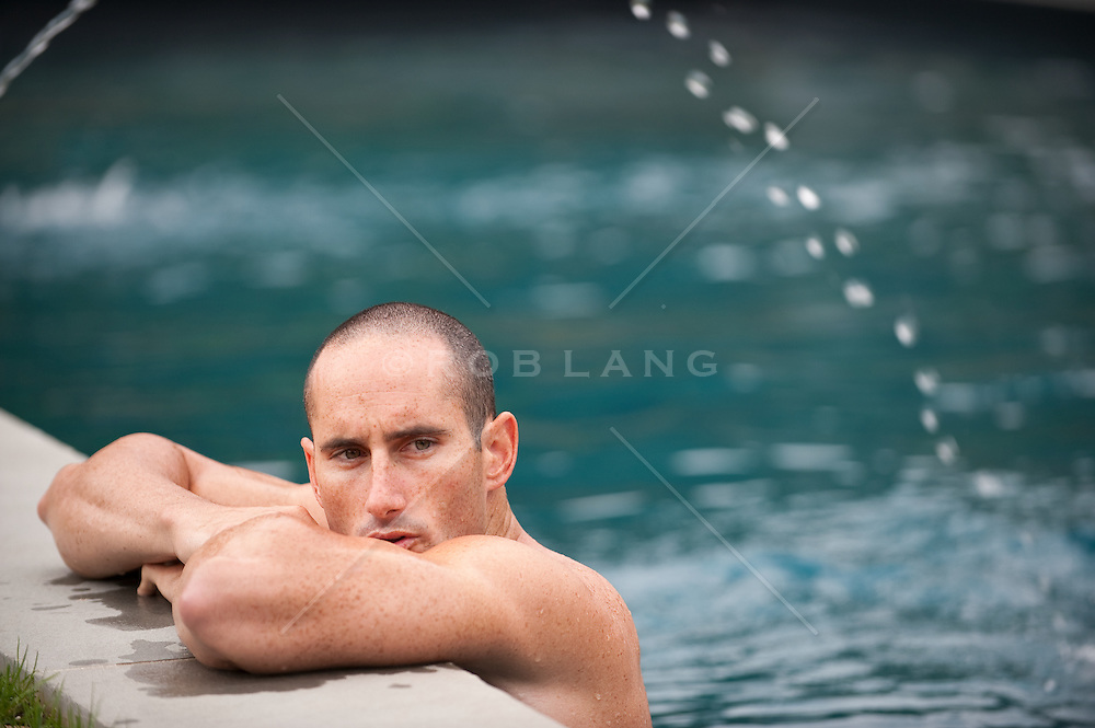 Man hanging out on the edge of a pool