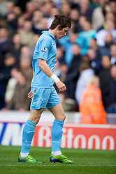 STOKE, ENGLAND - Sunday, October 19, 2008: Tottenham Hotspur's Gareth Bale walks off dejected after being sent off against Stoke City during the Premiership match at the Britannia Stadium. (Photo by David Rawcliffe/Propaganda)