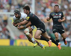 Saracens Outside Centre Duncan Taylor tackles Wasps Hooker Carlo Festuccia- Photo mandatory by-line: Alex James/JMP - 07966 386802 - 06/09/2014 - SPORT - RUGBY UNION - London, England - Twickenham Stadium - Saracens v Wasps - Aviva Premiership London Double Header.