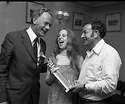 Pepsi Personality Girl, Swords.   (J64)..1975..13.07.1975..07.13.1975..13th July 1975..At Fingallian's GAA club, Ms Deirdre Murphy of St Columbas Road,Swords was selected as Miss Pepsi Personality Girl for the Swords district. Her selection was made at The Gala Marquee Dance in the club. the event was sponsored by Cantrell & Cochrane. The Dublin final will be held later this year...Picture shows Ms Deirdre Murphy receiving her trophy from (L) Mr Bill Cashe C&C,Area Manager and Mr Paddy Kelly,PRO Fingallian Festival Committee.