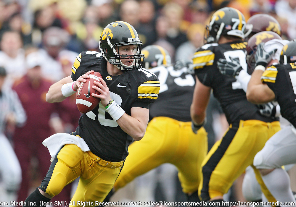 November 21, 2009: Iowa quarterback James Vandenberg (16) rolls out to pass during the second half of the Iowa Hawkeyes 12-0 win over the Minnesota Golden Gophers at Kinnick Stadium in Iowa City, Iowa on November 21, 2009.