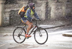 © Licensed to London News Pictures. 01/02/2019. London, UK. A bike rider braves freezing temperatures in his shorts, during heavy snowfall in Maida Vale, West London as large parts of the UK are deluged with snow and freeing temperatures. Photo credit: Ben Cawthra/LNP