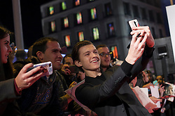 """03.12.2015, Callao Cinema, Madrid, ESP, Premiere, In the Heart of the Sea, im Bild British actor Tom Holland takes a selfie photography with fans // during the Madrid Premiere of the movie """" In the Heart of the Sea"""" at the Callao Cinema in Madrid, Spain on 2015/12/03. EXPA Pictures © 2015, PhotoCredit: EXPA/ Alterphotos/ Victor Blanco<br /> <br /> *****ATTENTION - OUT of ESP, SUI*****"""