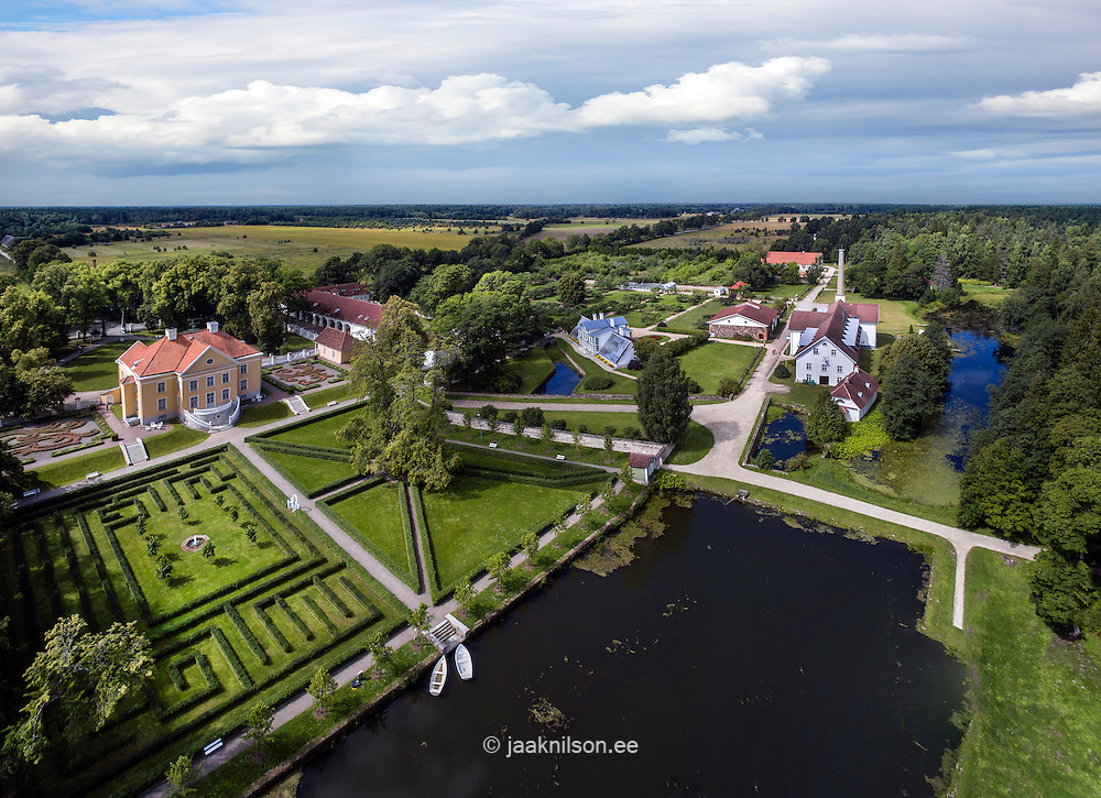 Palmse manor house in Estonia. Aerial view, old castle, park. Water and pond.