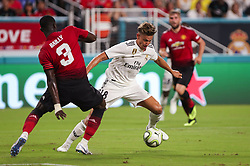 July 31, 2018 - Miami Gardens, Florida, USA - Real Madrid C.F. midfielder Marcos Llorente (18) competes for the ball over Manchester United F.C. defender Eric Bailly (3) during an International Champions Cup match between Real Madrid C.F. and Manchester United F.C. at the Hard Rock Stadium in Miami Gardens, Florida. Manchester United F.C. won the game 2-1. (Credit Image: © Mario Houben via ZUMA Wire)