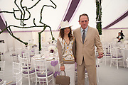 DAWN JONES; TOMMY LEE JONES<br /> Cartier International Polo. Guards Polo Club. Windsor Great Park. 25 July 2010. -DO NOT ARCHIVE-&copy; Copyright Photograph by Dafydd Jones. 248 Clapham Rd. London SW9 0PZ. Tel 0207 820 0771. www.dafjones.com.
