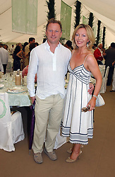 NICK JONES and KIRSTY YOUNG at the Cartier International polo at Guards Polo Club, Windsor Great Park, on 30th July 2006.<br />