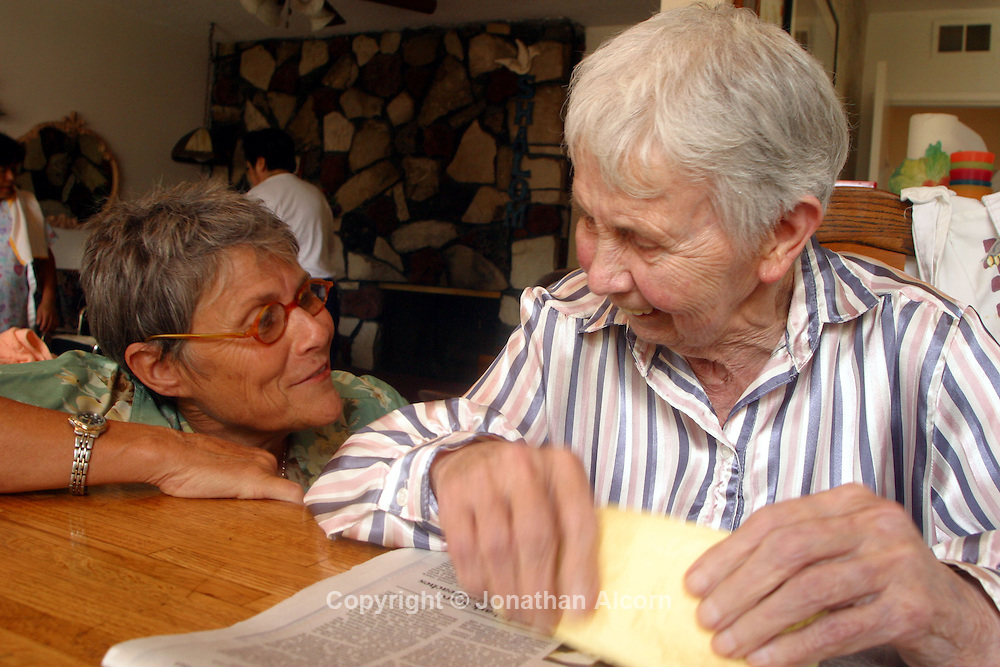 Linda , a healthcare professional, laughs with Betty.at a live-in residence for Alzheimer's and dementia related  patients.