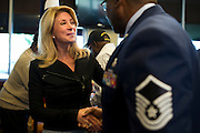 State Senator Wendy Davis speaks with Master Sargent Alfred Henderson at Luby's in Forrest Hill during their Veterans Day Breakfast on November 11, 2013.  (Cooper Neill / for The Texas Tribune)