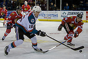 KELOWNA, CANADA - JANUARY 21:  Kelowna Rockets right wing Kole Lind #16, Portland Winterhawks center Ilijah Colina #12 and Portland Winterhawks defenseman Henri Jokiharju #16 at the Kelowna Rockets game on January 21, 2017 at Prospera Place in Kelowna, British Columbia, Canada.  (Photo By Cindy Rogers/Nyasa Photography,  *** Local Caption ***