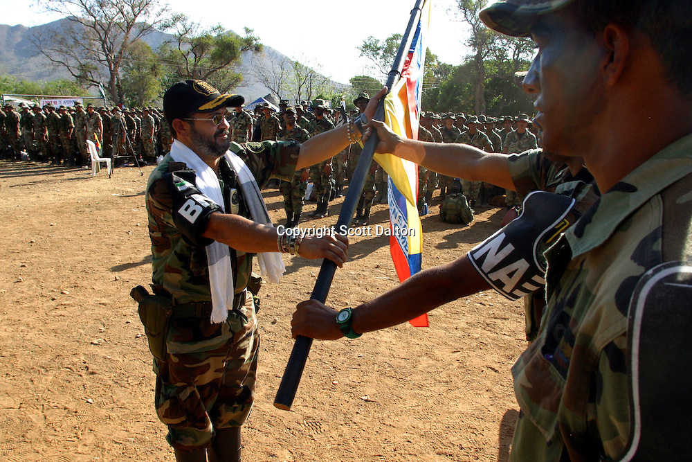 Jorge 40, or Rodrigo Tovar Pupo, the commander of the paramilitary group Bloque Norte, or Northern Block, turns over a paramilitary flag during rehearsal for a disarmament ceremony in La Mesa in northern Colombia on March 10, 2006. An estimated 24,000 paramilitary members have turned in their weapons as part of a government negotiated peace deal. But some are skeptical if the government plan will really work and if the paramilitary members will be successful in their transformation to civilian life. (Photo/Scott Dalton)