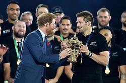 Prince Harry presents the Webb Ellis Cup to Richie McCaw of New Zealand - Mandatory byline: Patrick Khachfe/JMP - 07966 386802 - 31/10/2015 - RUGBY UNION - Twickenham Stadium - London, England - New Zealand v Australia - Rugby World Cup 2015 Final.