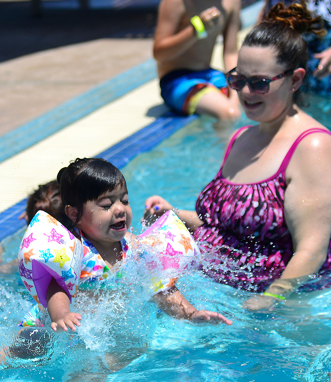 apl062117f/ASECTION /pierre-louis/JOURNAL 062117<br /> 2 year-old Nova Chino,, left, makes a splash in front of her mother Amanda Chino,, while the pair seeks  relief from Wednesday's sweltering temperatures at the West Mesa Aquatic Center .Photographed  on Wednesday June  21,  2017. .Adolphe Pierre-Louis/JOURNAL