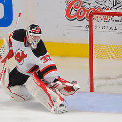 May 16, 2012: New Jersey Devils goalie Martin Brodeur (30) makes a glove save while falling backwards during second period action in game 2 of the NHL Eastern Conference Finals between the New Jersey Devils and New York Rangers at Madison Square Garden in New York, N.Y.