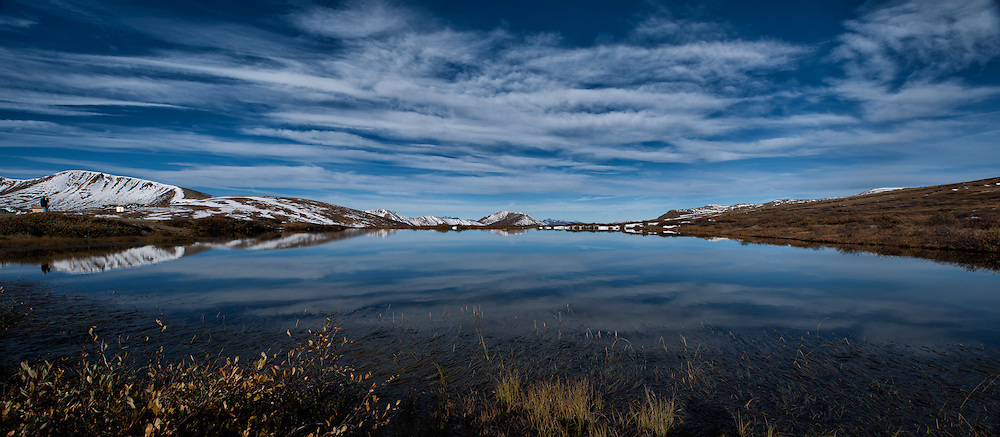 Morning Reflections in a Pond at Independence Pass, Colorado. Composite of 3 images taken with a Nikon D3x and 24 mm f/3.5 PC-E lens (ISO 100, 24 mm, f/16, 1/160 sec) combined using AutoPano Giga Pro 3. Day 3 on a Colorado Rockies Photo Safari with Jason Odell.