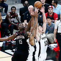 01 May 2017: Houston Rockets center Clint Capela (15) vies for the rebound with San Antonio Spurs forward David Lee (10) and San Antonio Spurs forward Kawhi Leonard (2) during the Houston Rockets 126-99 victory over the San Antonio Spurs, in game 1 of the Western Conference Semi Finals, at the AT&T Center, San Antonio, Texas, USA.