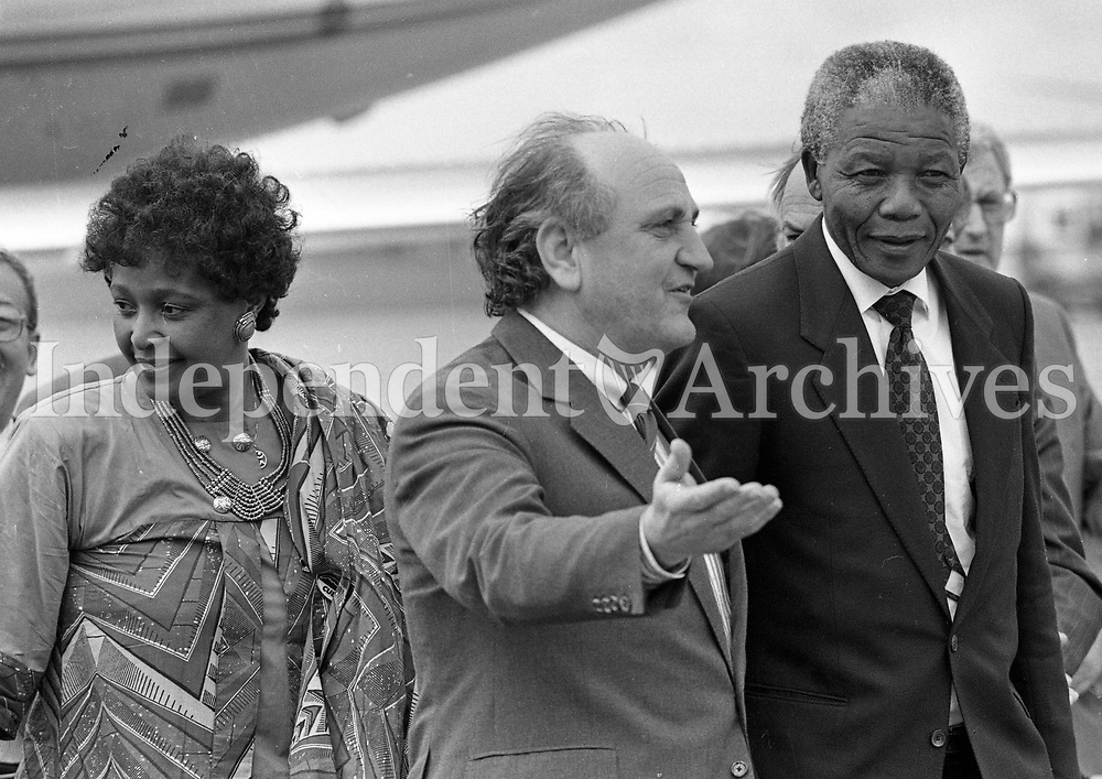 Nelson Mandela arrives at Dublin Airport, accompanied by the Minister for Foreign Affairs Gerry Collins, 01/07/1990 (Part of the Independent Newspapers Ireland/NLI Collection).
