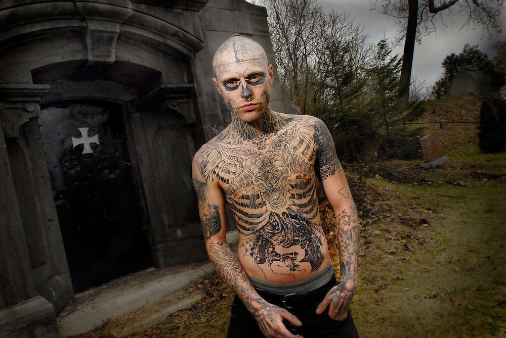 The man known as 'Zombie'. This 22 year old man has tattooed his whole body and face to resemble a zombie - a walking, decomposed corpse. He spent more than 24 hours under the needle and more than $8,000 (Canadian dollars) photographed by Neville Elder in Canada.