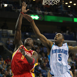 Jan 02, 2010; New Orleans, LA, USA; Houston Rockets guard Jermaine Taylor (8) shoots over New Orleans Hornets guard Marcus Thornton (5) during the second quarter at the New Orleans Arena. Mandatory Credit: Derick E. Hingle-US PRESSWIRE