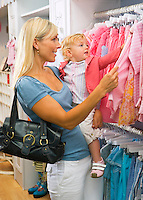 Toddler girl and Mother shop for kids clothes..Model Release property Release:.20070820_MR_B.20070820_MR_C.20070820_PR_A