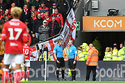 The referee speaks to the linesman as Bristol City fans watch on and wait for a decision during the EFL Sky Bet Championship match between Hull City and Bristol City at the KCOM Stadium, Kingston upon Hull, England on 5 May 2019.