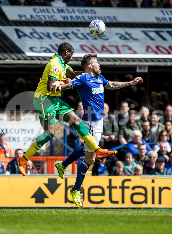 Sebastien Bassong of Norwich City  wins a header against Daryl Murphy of Ipswich Town during the Sky Bet Championship Play Off 1st Leg match between Ipswich Town and Norwich City at Portman Road, Ipswich, England on 9 May 2015. Photo by Liam McAvoy.