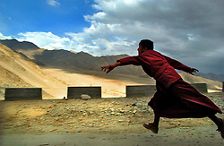 LEH, KASHMIR, INDIA, MAY 8, 2004: A Ladakhi child who is studying to become a monk plays outside Thiksey Monastaryon the eve of the last round of elections in the mountainous region of Leh, Ladakh in the Indian held state of Jammu and Kashmir, May 8, 2004.   (Ami Vitale/Getty Images)